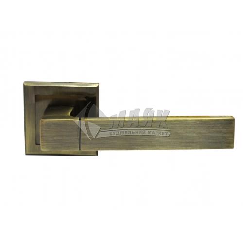 Ручки дверні на розетці LINDE A-2004 AB стара бронза